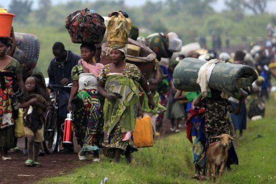 FAMILIES FLEEING VIOLENCE WALK TOWARD EASTERN CONGO