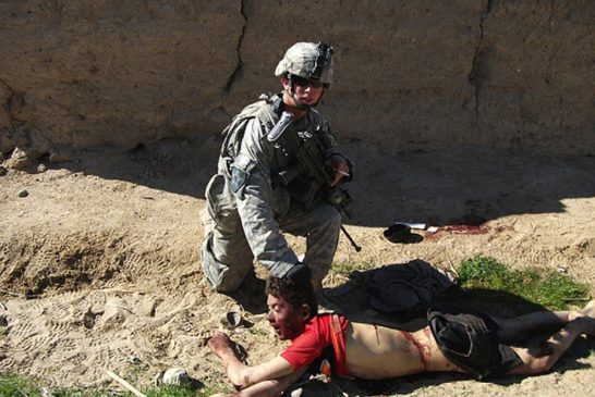 Andrew_Holmes_pulling_a_dead_Afghan_boy_by_the_hair_in_2010