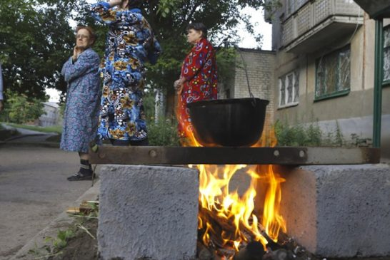 Large.-Residents-cooking-outside