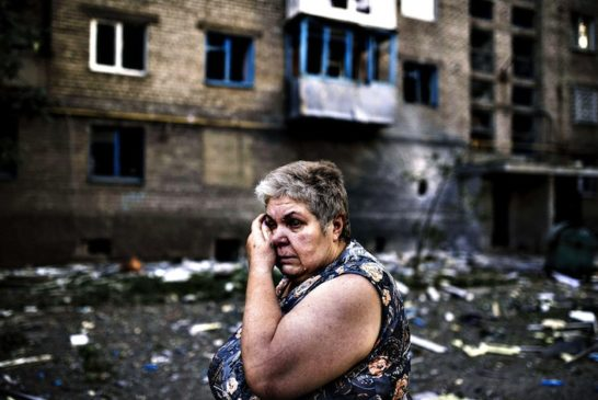 TOPSHOTSA woman reacts after shelling i...TOPSHOTSA woman reac