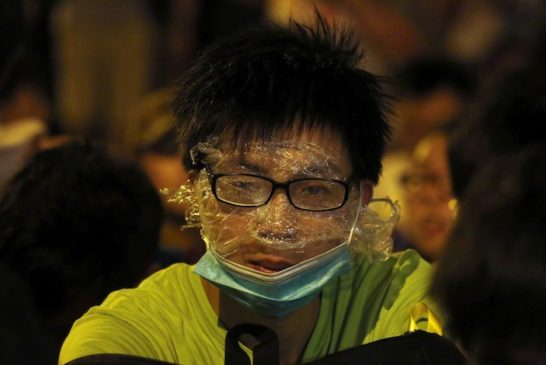 A protester wearing rudimentary protection against pepper spray is pictured in Hong Kong