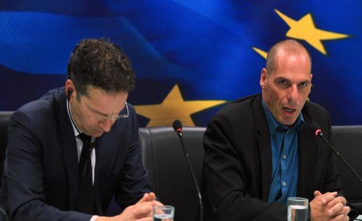 Il presidente dell' Eurogruppo Jeroen Dijsselbloem e Yanis Varoufakis, neo ministro delle Finanze greco
